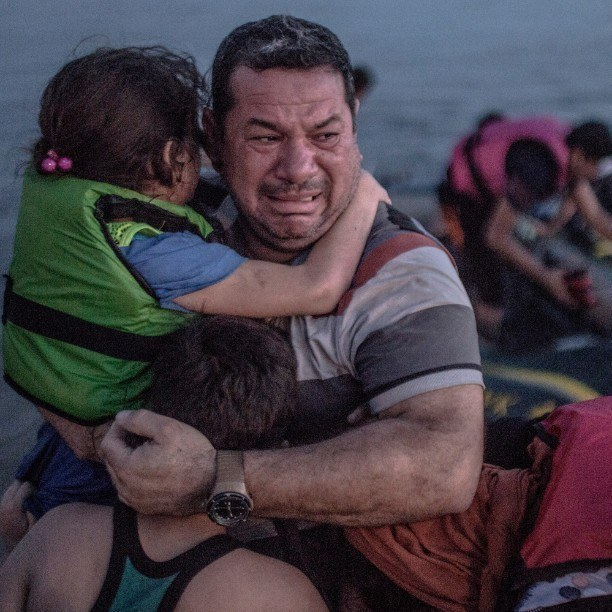 Syrian refugee in tears of joy arriving in Kos, Greece by Oguzhan Ali / Flickr